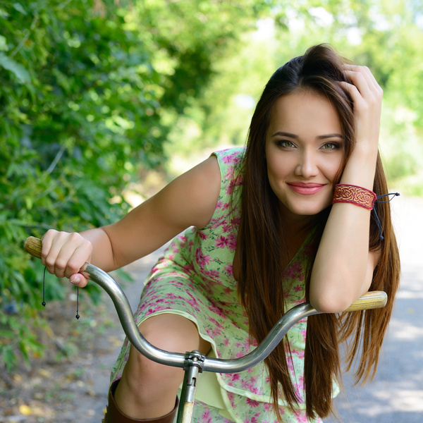 Beautiful girl riding bike Stock Photo