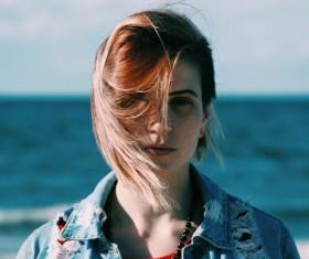 Beautiful young woman posing on beach Stock Photo