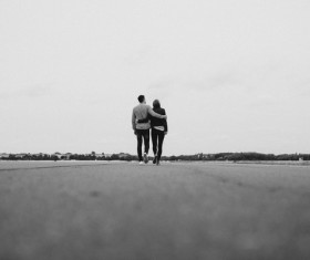 Black white picture of romantic couple on road Stock Photo