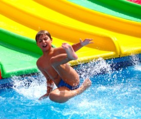 Boy in amusement park play water slides Stock Photo 01