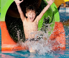 Boy in amusement park play water slides Stock Photo 02