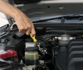 Car oil inspection Stock Photo