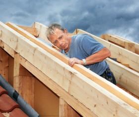 Carpenter building roof Stock Photo