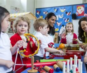Children on music lessons Stock Photo