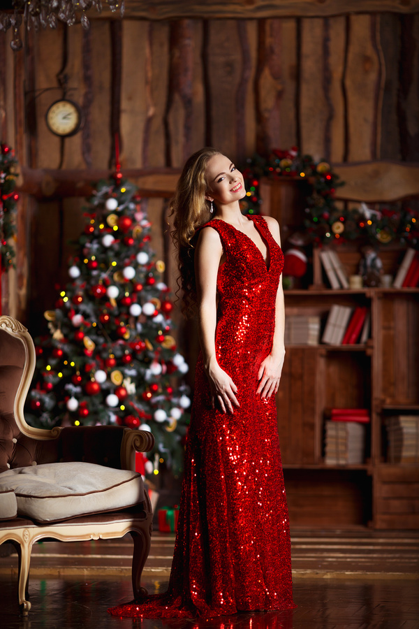 Christmas decorated room and lady in red dress Stock Photo