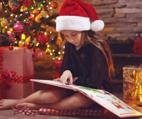 Christmas little girl reading comic book Stock Photo