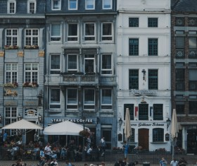Classical architectures in crowded town Stock Photo