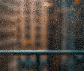 Closeup of wet raindrops on glass surface Stock Photo