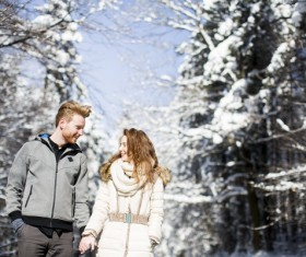 Couple walking outdoors in winter day Stock Photo
