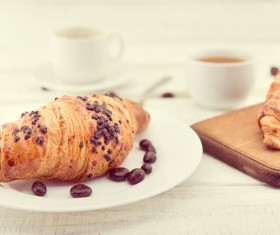 Croissants and chocolate beans in the plate Stock Photo