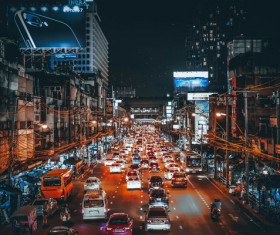 Crowded vehicles in busy city at night Stock Photo