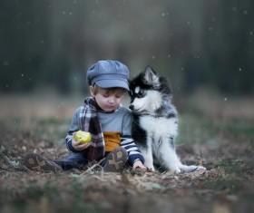 Cute beautiful little boy with pet dog Stock Photo