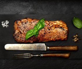 Cutlery and the fried steak Stock Photo