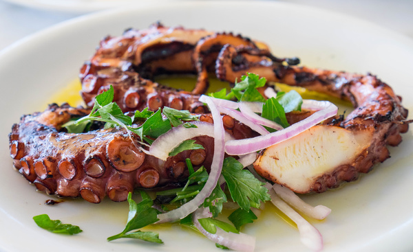 Delicious grilled octopus Stock Photo