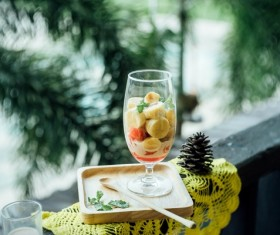 Delicious healthy fruits desert in wineglass Stock Photo