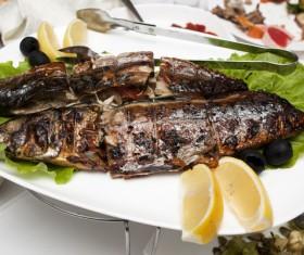 Delicious lemon roasted fish Stock Photo