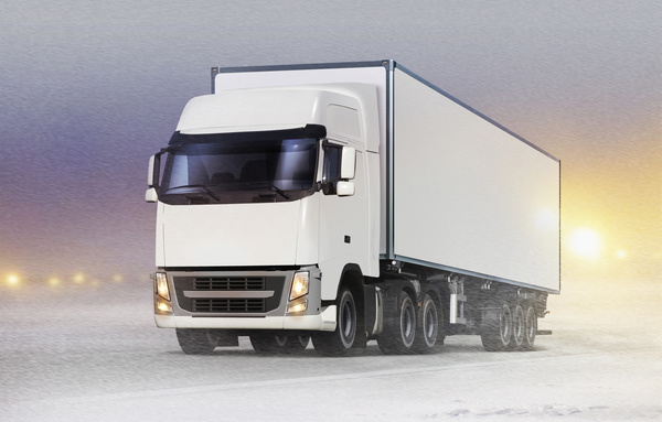 Delivery Trucks on the Winter Road Stock Photo
