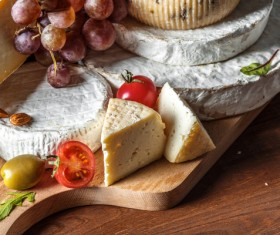 Different sorts of cheese on wooden table Stock Photo 01