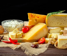 Different sorts of cheese on wooden table Stock Photo 02