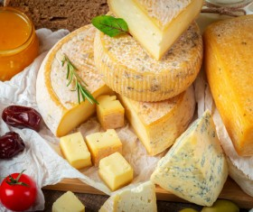 Different sorts of cheese on wooden table Stock Photo 03