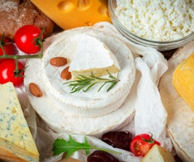 Different sorts of cheese on wooden table Stock Photo 04