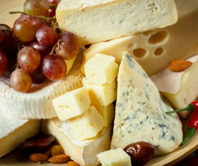 Different sorts of cheese on wooden table Stock Photo 05