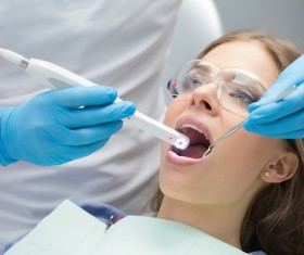 Doctors treat patients dental problems Stock Photo