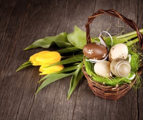 Easter eggs and flowers in the desktop basket Stock Photo 01
