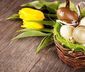 Easter eggs and flowers in the desktop basket Stock Photo 02