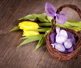 Easter eggs and flowers in the desktop basket Stock Photo 03