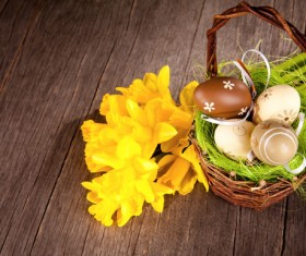 Easter eggs and flowers in the desktop basket Stock Photo 04