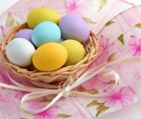 Easter eggs in the desktop basket Stock Photo