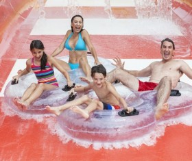 Family playing water slides Stock Photo