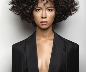 Fashion curly hair woman in black suit Stock Photo 01