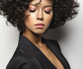 Fashion curly hair woman in black suit Stock Photo 02