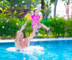 Father and daughter play in the water Stock Photo