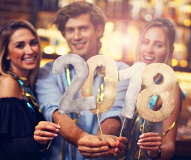 Friends celebrating New Year Stock Photo 01