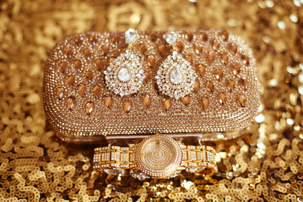 Gemstone Golden ladies handbag and watch with gemstone earrings Stock Photo 01
