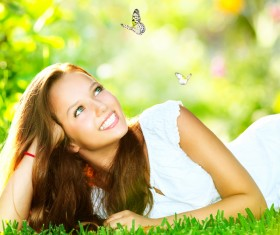 Girl and butterfly lying on the grass Art photography Stock Photo