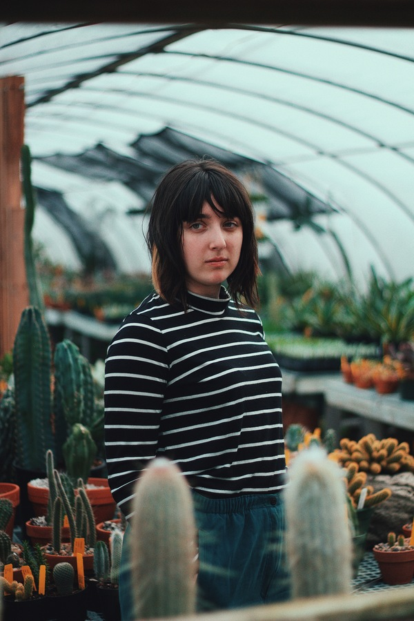 Girl in the greenhouse Stock Photo