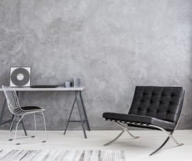 Gray wall and black sofa indoor Stock Photo