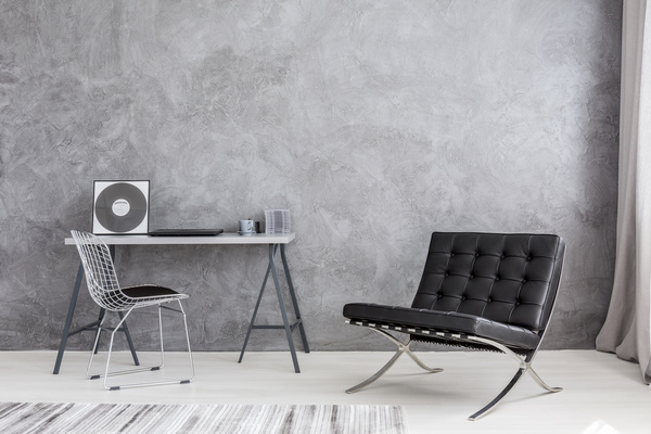 Gray wall and black sofa indoor Stock Photo