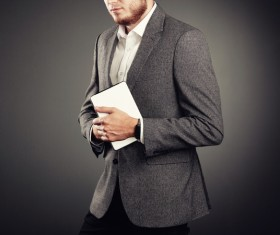 Handsome young man in business suit holding tablet PC Stock Photo 01