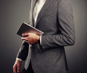 Handsome young man in business suit holding tablet PC Stock Photo 02