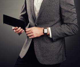 Handsome young man in business suit holding tablet PC Stock Photo 03