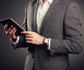 Handsome young man in business suit holding tablet PC Stock Photo 04
