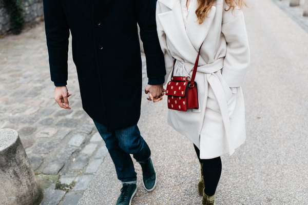 Happy couple hand in hand on road Stock Photo