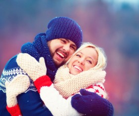 Happy couple hugging outdoors Stock Photo