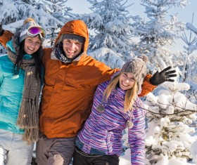 Happy friends outdoors in winter photo Stock Photo