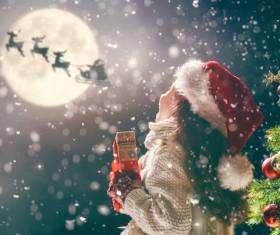 Happy girl holding Christmas gift Stock Photo 02